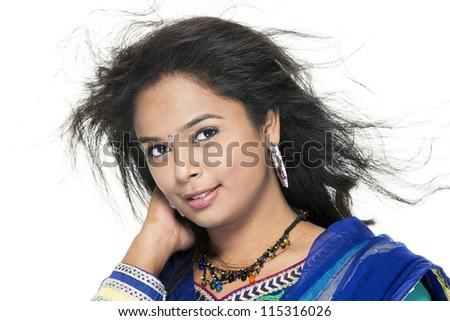 Indian Beautiful girl enjoying the wind on white. - stock photo