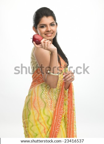 Indian beautiful girl with sari holding fresh red apple