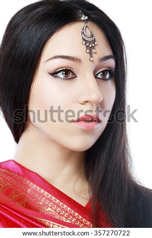 Indian beauty face close up perfect make up. Series. young beautiful brunette in traditional national dress - stock photo