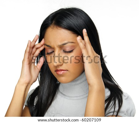 Indian beauty has a headache caused by stress - stock photo