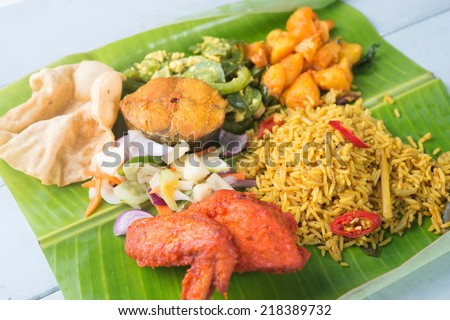 Indian biryani mixed rice on wooden dining table. - stock photo