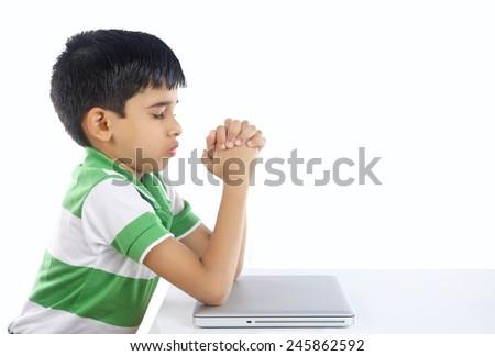 Indian Boy Praying with Laptop - stock photo