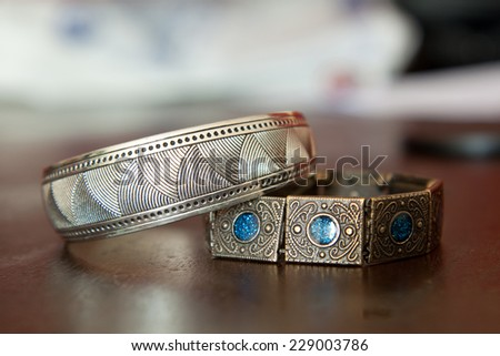 Indian bracelets with many symbols - stock photo
