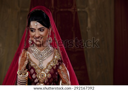 Indian bride in traditional clothing and jewelry - stock photo