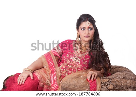 indian bride wearing red dress - stock photo