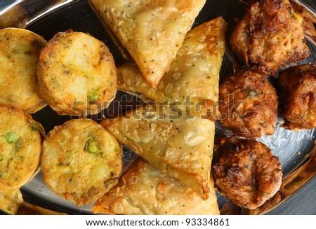 Indian buffet food with samosa, bhaji and pakora - stock photo