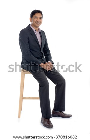 indian business male sitting - stock photo