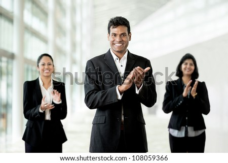 Indian business man and his team applauding good news - stock photo