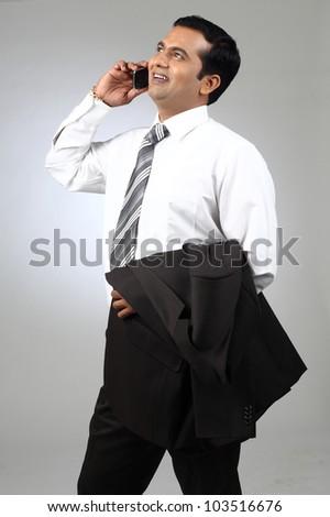 indian business man enjoying a conversation over cellphone - stock photo