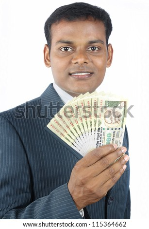 indian business man holding indian money - stock photo