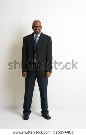indian business man in a coat - stock photo