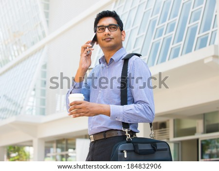 indian business man on a phone  - stock photo