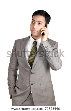 Indian Business man using cellphone. Isolated on a white background. - stock photo