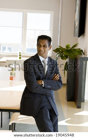 Indian Business Man with Arms Folded Indoors - stock photo
