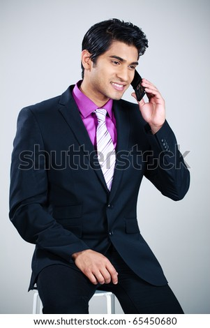 Indian business man with cellphone - stock photo