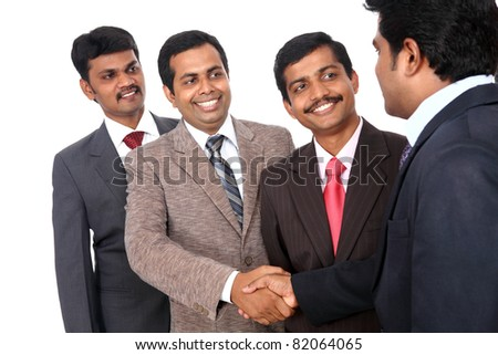 Indian business people shaking hands - stock photo