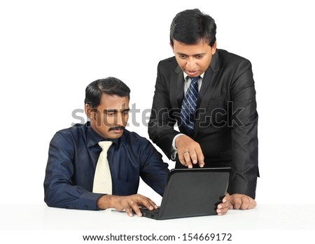 Indian business people with Laptop - stock photo