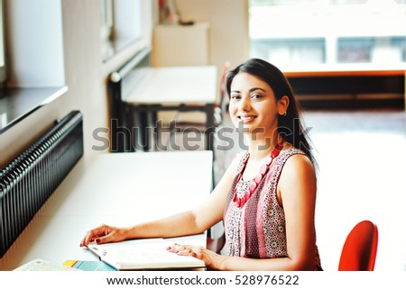 Indian business woman sitting at the table