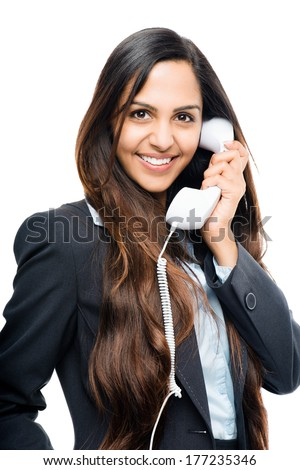 Indian business woman talking on phone isolated white background - stock photo