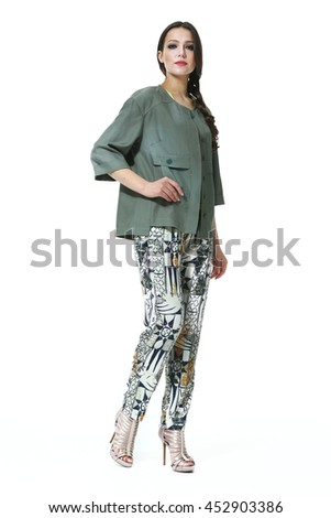 indian business woman with straight hair style in summer print trousers and casual jacket high heel shoes full body length isolated on white - stock photo