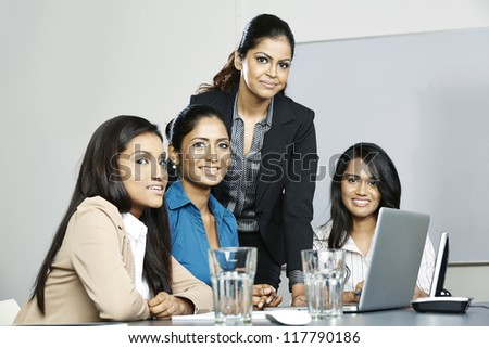 Indian business women working together on a project - stock photo