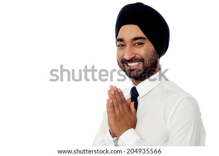 Indian businessman showing welcome gesture - stock photo