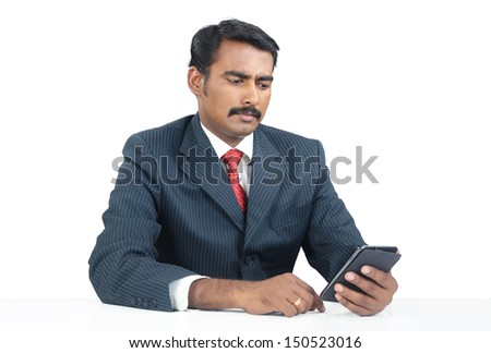 Indian Businessman with Cellphone - stock photo