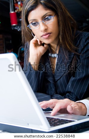 indian businesswoman concentrate on a laptop computer - stock photo