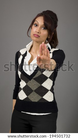Indian businesswoman making stop gesture and showing stop - stock photo
