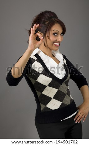 Indian businesswoman showing ok sign isolated on colored background - stock photo