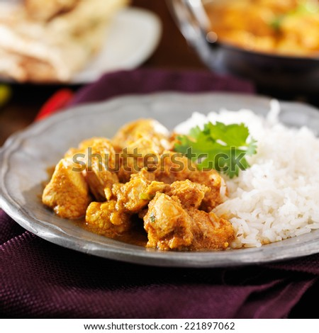 indian butter chicken curry with basmati rice - stock photo