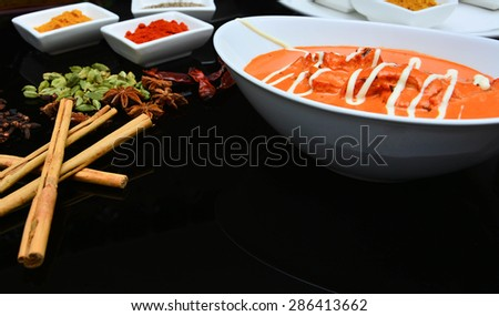 Indian Butter Chicken from Indian Restaurant served in white bowl - stock photo