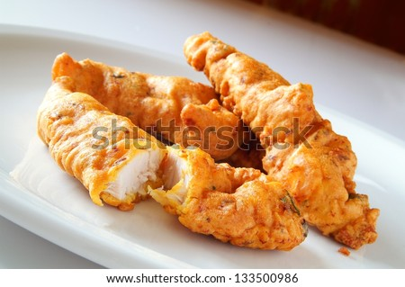 indian chicken pakora on white plate - stock photo