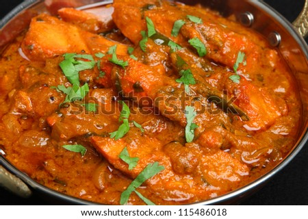 Indian chicken tikka jalfrezi curry in balti dish.