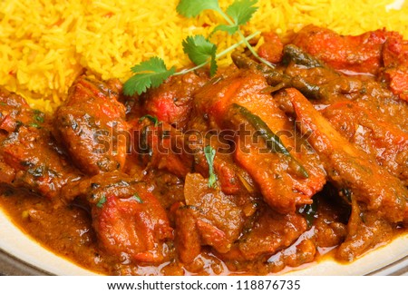 Indian chicken tikka jalfrezi curry with pilau rice