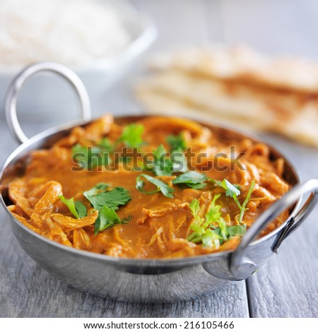 indian chicken tikka masala in balti dish - stock photo
