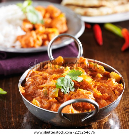 indian chicken vindaloo curry in balti dish close up - stock photo