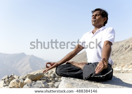 Indian classic art Yoga performed in Mountain by Male artist