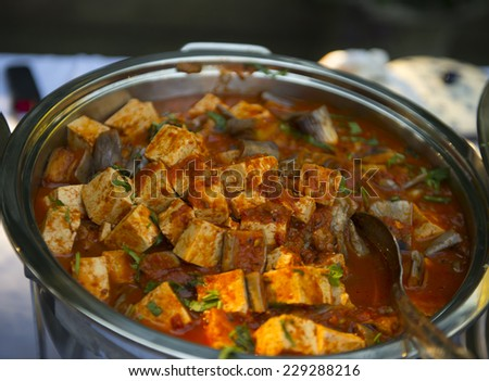 Indian cottage cheese cooked with special spices - stock photo