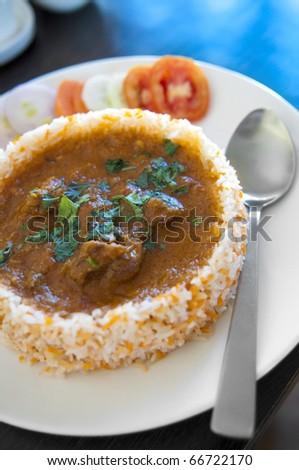 Indian Cuisine - Biryani chicken rice - stock photo