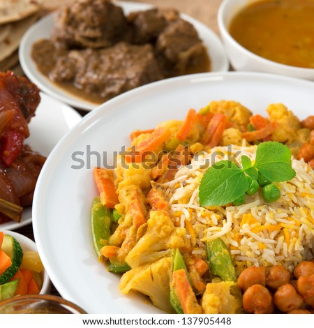 Indian cuisine biryani rice and curry.