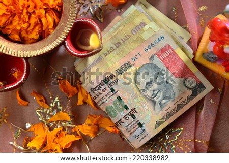 Indian currency bills with traditional lamp - a top angle view - stock photo