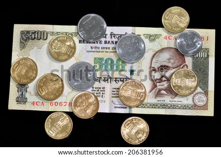 Indian currency note and coins - stock photo