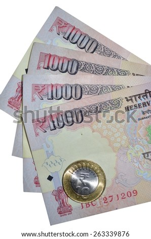 Indian currency notes of denomination 1000 with rupee coin of value 10 - stock photo