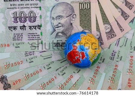 Indian Currency Notes Rupees with a Globe on it - stock photo