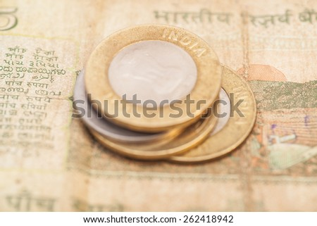 Indian Currency Rupee Notes and Coins - stock photo