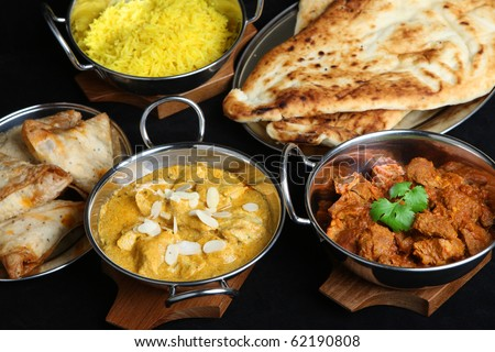 Indian curries and accompaniments - stock photo