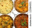 Indian curries in stainless steel balti dishes - stock photo