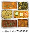 Indian curries & rice in takeaway food containers. - stock photo