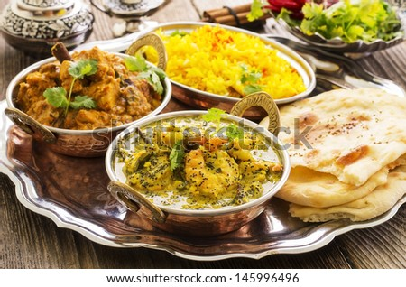indian curries with rice and bread  - stock photo